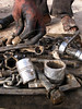 A scavenger picks up tools while working at a junk yard of scrap military hardware, an eerie desert momument to Iraq's history of wars with Iran, Kuwait and the United States, south of Baghdad.(Australfoto/Douglas Engle)