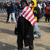 In my election night gallery, I said you don't usually see Black people wearing the US flag (unless it is James Brown or a track gold-medalist).  I may be mistaken, but it seems a lot more common these days for some reason.  8-)