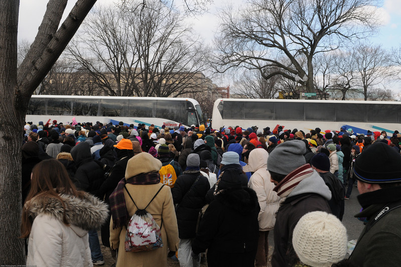 The buses along Constitution Ave were used as mobile walls to divert traffic around the parade.  They were vrey aggressive at not letting people cut between and would lurch forward as people tried - which nearly crushed at least 2-3 people while I stood there for 10 mins watching the spectacle.