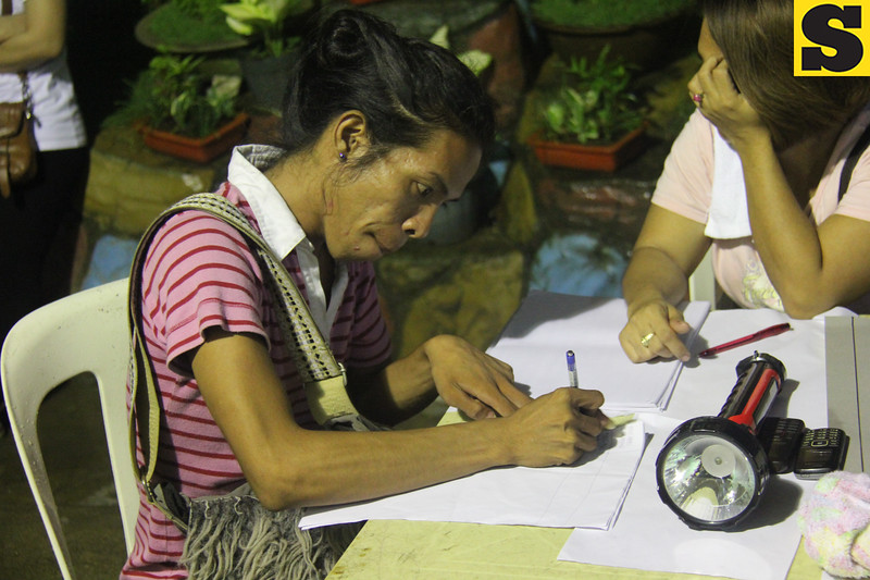 A barangay elections candidate supporter tallies the results