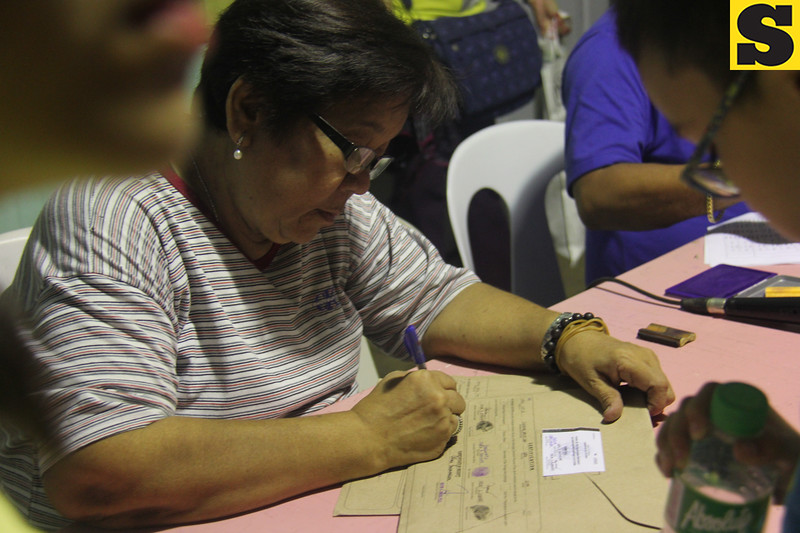 Checking of election returns during the canvassing of votes in Guadalupe, Cebu City