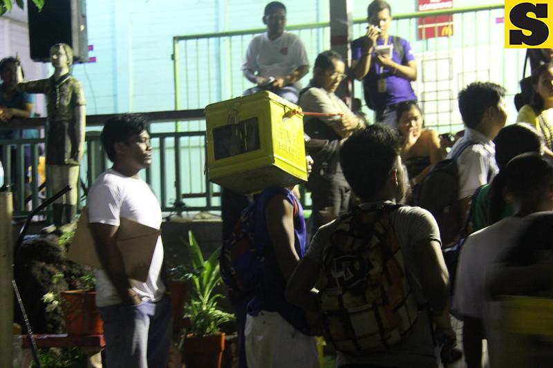 A man carrying a ballot box in Guadalupe, Cebu City