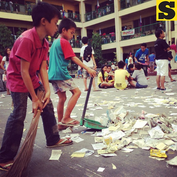 CLEAN-UP. While the counting of votes is ongoing at the Cebu City Central School, these kids take time to clean the cluttered campus. #barangayelections2013