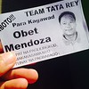 A person who gives direction of polling precincts hands out flyers of candidates like this one at the entrance of Bigaa Elementary School, Balagtas, Bulacan