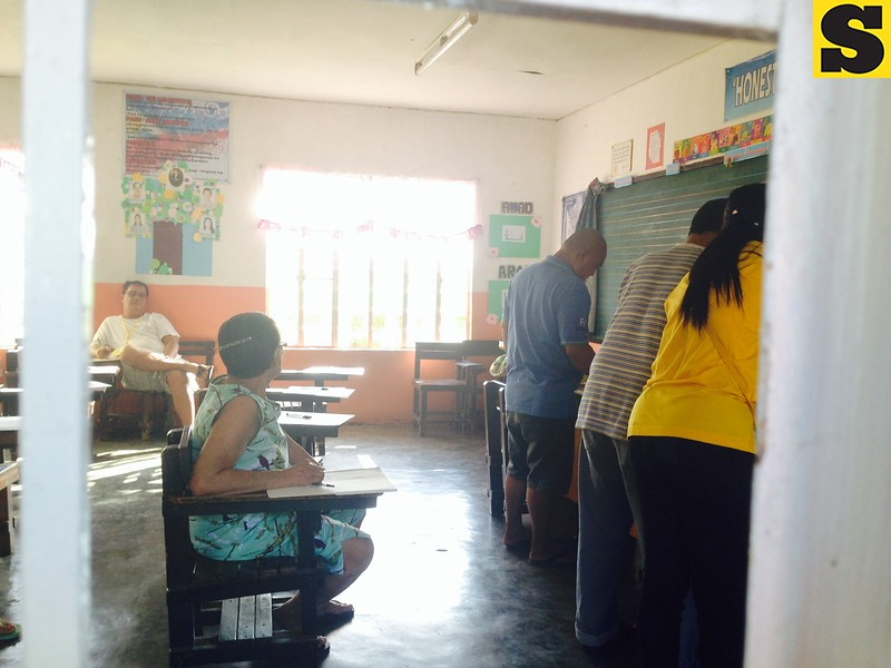 An elderly woman was given the front most seat inside a polling precinct at Bigaa Elementary School, Balagtas, Bulacan