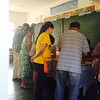 Early voters looking for their names inside a polling precinct at Bigaa Elementary School, Balagtas, Bulacan