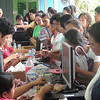 "CEBU. Comelec personnel and volunteers assist residents in Guadalupe who came to vote ""yes"" or ""no"" on Republic Act 9905, creating Banawa-Englis a separate barangay. (Laureen Mondonedo/Sunnex)"