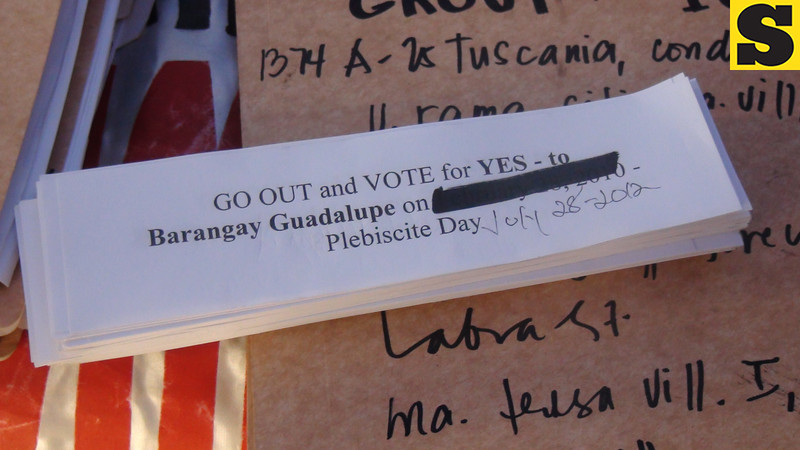 CEBU. Leaflets given to residents voting yes to splitting Barangay Guadalupe in Cebu City. (Laureen Mondonedo/Sunnex)