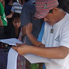 CEBU. This man looks for his name in the list of residents voting for splitting Barangay Guadalupe. A plebiscite was held Saturday, July 28, 2012. (Laureen Mondonedo/Sunnex)