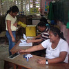 CEBU. Persons handlign the plebiscite in Barangay Guadalupe. (Laureen Mondonedo/Sunnex)