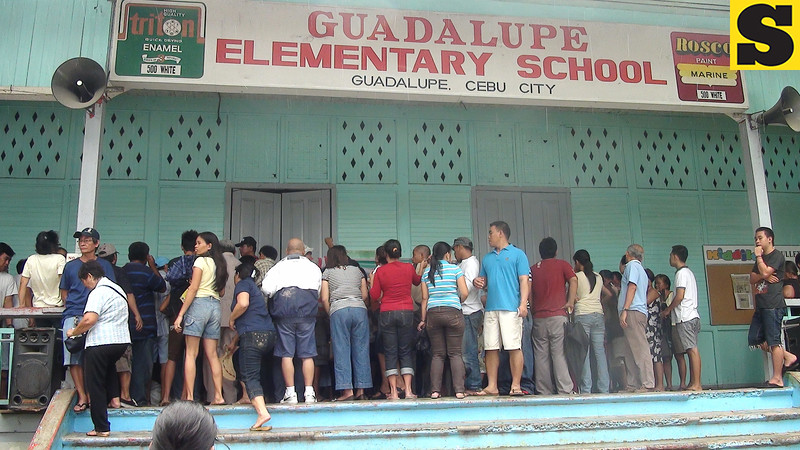 CEBU. Voters wait for their turn to be called during a plebiscite on proposed Guadalupe split Saturday, July 28, 2012.  These residents asked for their precinct numbers. (Laureen Mondonedo/Sunnex)