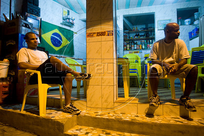 Waldinei Medina, 29, left, and David Bispo, 38, in the Chapeu Mangueira slum of Rio de Janeiro, Brazil, Sept. 30, 2010, where Federal Deputy candidate Benedita da Silva is also from. Benedita, as she is known, was the first afro-Brazilian senator and the first female and black governor of the state of Rio de Janeiro and later Social Action Secretary in President Lula's government, where she was accused of using public resources to finance a personal trip. She resigned the post in 2004.(Australfoto/Douglas Engle)
