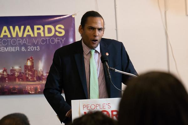 Estevan Bassett-Nembhard, NYC Organizer for the Communist Party USA, opens the day's event.