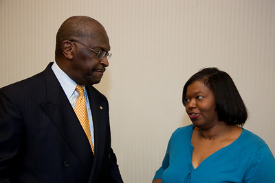More than a dozen African American conservatives gathered in Washington DC on August 4, 2010 to help the Tea Party Express fight back against accusations of racism.  (L) Herman Cain, National Radio Talk Show Host (R) Mary Baker, Conservative Moms for America (Photo by Jeff Malet)