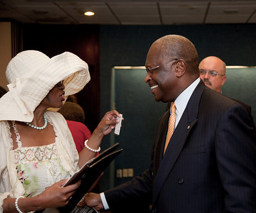 "More than a dozen African American conservatives gathered in Washington DC on August 4, 2010 to help the Tea Party Express fight back against accusations of racism.  (L) Ruth Bryant White, Editor In Chief of BreakingNewsJournal.Net, Leader on Conservative Moms For America and author of ""Life Through The Eyes Of An Interracial Couple"" (R) Herman Cain, National Radio Talk Show Host (Photo by Jeff Malet)"