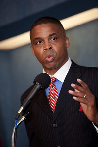 Timothy F. Johnson, Ph.D of The Frederick Douglass Foundation, joined more than a dozen African American conservatives gathered in Washington DC on August 4, 2010 to help the Tea Party Express fight back against accusations of racism. He told the audience that the NAACP is not relevant anymore (Photo by Jeff Malet)