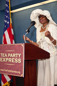 "Ruth Bryant White, Editor In Chief of BreakingNewsJournal.Net, Leader on Conservative Moms For America and author of ""Life Through The Eyes Of An Interracial Couple"", joined more than a dozen African American conservatives gathered in Washington DC on August 4, 2010 to help the Tea Party Express fight back against accusations of racism. (Photo by Jeff Malet)"