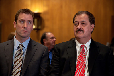 Waiting to testify.M. Shane Harvey (left), general counsel for Massey is responsible for legal matters involving environmental compliance, health and safety compliance and federal and state regulatory issues. Massey Energy CEO Don Blankenship (right) took his first congressional scolding since an explosion at one of his West Virginia coal mines killed 29 last month. He testified at a hearing of the Appropriations Subcommittee on Labor, Health and Human Services, and Education on May 20, 2010 on Capitol Hill in Washington DC. ( Photo by Jeff Malet)