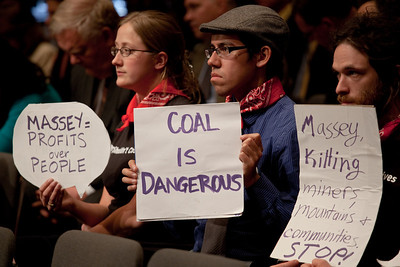 Protestors sit behind Massey Energy CEO Don Blankenship  as he took his first congressional scolding since an explosion at one of his West Virginia coal mines killed 29 last month. He testified at a hearing of the Appropriations Subcommittee on Labor, Health and Human Services, and Education on May 20, 2010 on Capitol Hill in Washington DC. ( Photo by Jeff Malet)