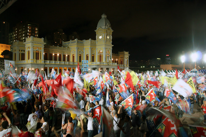Supporters of Brazilian President Luis Inacio Lula da Silva wave flags during a campaign rally in Belo Horizonte, capital of the southeastern state of Minas Gerais, Brazil, 2006. In spite of a series of corruption scandals which have stained his images, opinion polls show that Lula should win in the first round of the Oct. 1, 2006 election.(Australfoto/Douglas Engle)