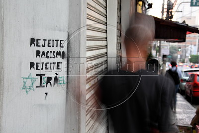 "A spray-painted sign reading ""Reject Racism Reject Iran"" on a street in Sao Paulo, Brazil has been changed to read ""Reject Racism Reject Israel."" A poll from 2011 showed both Israel and Iran as the two least popular countries among Brazilians and Latin Americans, paradoxically putting  the two countries, at odds on the world political scene, into the same categorty. For Latin Americans, they seem to be mirror reflections of each other. (Australfoto/Douglas Engle)"