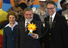 Brazil's President Luiz Inacio Lula da Silva, center, and his wife Marisa Leticia, left, and Carlos Arthur Nuzman, Brazilian Olympic Committee president, right, pose for a photo with the Pan American Games 2007 mascot at Forte de Copacabana, Rio de Janeiro, Brazil, July 13, 2006. The Organizing Committee of the XV Pan American Games Rio 2007 (CO-RIO) is presenting the Mascot of the 2007 Rio Games, which is the sun. The Pan Am Games involve athletes from the Caribbean, North, Central and South America.. (Australfoto/Renzo Gostoli)
