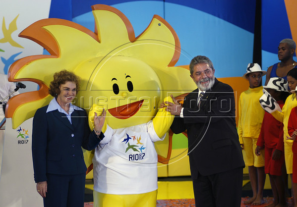 Brazil's President Luiz Inacio Lula da Silva, right, and his wife Marisa Leticia, left, pose for a photo with the Pan American Games 2007 mascot at Forte de Copacabana, Rio de Janeiro, Brazil, July 13, 2006. The Organizing Committee of the XV Pan American Games Rio 2007 (CO-RIO) is presenting the Mascot of the 2007 Rio Games, which is the sun. The Pan Am Games involve athletes from the Caribbean, North, Central and South America. (Australfoto/Renzo Gostoli)