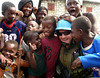 A Brazilian soldier is greeted by friendly children in Haiti. The Brazilian military, with 1,300 troops in the Caribbean nation, leads a force of 7,000 UN troops there since 2004. The mission is part of an effort by Brazil to take a larger role on the international stage - which some analysts say is a part of Brazil's desire for a seat on an eventual larger UN security council. Brazil has also accepted Palestinian refugees from Iraq. (Australfoto/Tom Phillips)<br /> STORY AVAILABLE