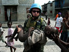 A Brazilian soldier carries an injured child in Haiti. The Brazilian military, with 1,300 troops in the Caribbean nation, leads a force of 7,000 UN troops there since 2004. The mission is part of an effort by Brazil to take a larger role on the international stage - which some analysts say is a part of Brazil's desire for a seat on an eventual larger UN security council. Brazil has also accepted Palestinian refugees from Iraq. (Australfoto/Tom Phillips)<br /> STORY AVAILABLE