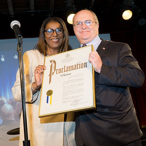 Tish James presents a Public Advocate's Proclamagtion to long-time Assemblyman, James Brennan.