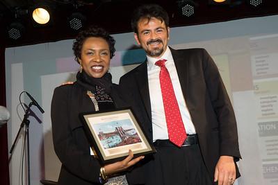 Congressswoman Yvette Clarke accepts her award from Josh Silverstein.