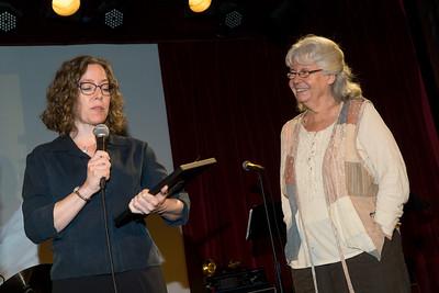 First Vice-President Joy Romanski presents the CBID award to Ellen Raider, a long-time community activist.