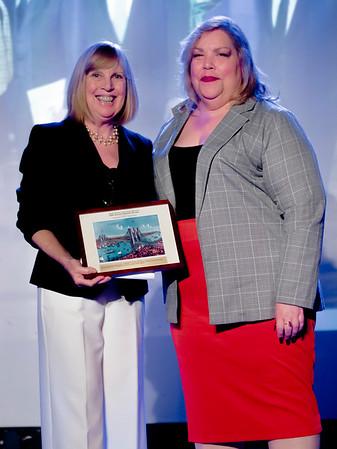 Carroll presents Medina with the CBID honors award.