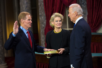 Senator Bill Nelson (D-FL) is sworn in by Vice President Joe Biden. His wife Grace Cavert Nelson holds a bible. The ceremonial event took place in the Old Senate Chamber inside the U.S. Capitol Building in Washington D.C. on January 3, 2013. The official swearing-in ceremony happened earlier in the Senate chambers on the opening day of the 113th Congress. (Photo by Jeff Malet).