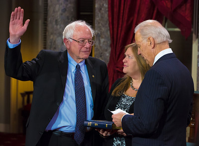 U.S. Sen. Bernie Sanders (I-VT) (L) participates in a reenacted swearing-in with his wife Jane O'Meara Sanders and Vice President Joe Biden. The ceremonial event took place in the Old Senate Chamber inside the U.S. Capitol Building in Washington D.C. on January 3, 2013. The official swearing-in ceremony happened earlier in the Senate chambers on the opening day of the 113th Congress. (Photo by Jeff Malet).