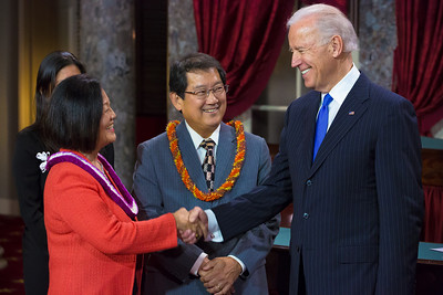 U.S. Senator Mazie Hirono (D-HI) (left) participates in a reenacted swearing-in with her husband Leighton Kim Oshima and Vice President Joe Biden. The ceremonial event took place in the Old Senate Chamber inside the U.S. Capitol Building in Washington D.C. on January 3, 2013. The official swearing-in ceremony happened earlier in the Senate chambers on the opening day of the 113th Congress. (Photo by Jeff Malet).