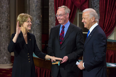 U.S. Senator Elizabeth Warren (D-MA) (left) participates in a reenacted swearing-in with her husband Bruce Mannand (center) and Vice President Joe Biden. The ceremonial event took place in the Old Senate Chamber inside the U.S. Capitol Building in Washington D.C. on January 3, 2013. The official swearing-in ceremony happened earlier in the Senate chambers on the opening day of the 113th Congress. (Photo by Jeff Malet).
