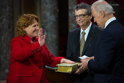 Senator Heidi Heitkamp (D-ND) (left) participates in a reenacted swearing-in with her husband Darwin Lange (center) and U.S. Vice President Joe Biden a reenacted swearing-in with Vice President. The ceremonial event took place in the Old Senate Chamber inside the U.S. Capitol Building in Washington D.C. on January 3, 2013. The official swearing-in ceremony happened earlier in the Senate chambers on the opening day of the 113th Congress. (Photo by Jeff Malet).