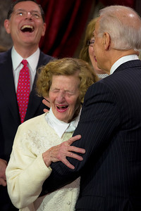 "U.S. Senator John Barrasso (R_WY) (left) participates in a reenacted swearing-in with his wife and Vice President Joe Biden. In photo, Biden flirts with the senator's 90 year old mother Louise. Here he pulls her by the waist to stand next to him joking ""take a chance, ruin your reputation here."" The ceremonial event took place in the Old Senate Chamber inside the U.S. Capitol Building in Washington D.C. on January 3, 2013. The official swearing-in ceremony happened earlier in the Senate chambers on the opening day of the 113th Congress. (Photo by Jeff Malet)."