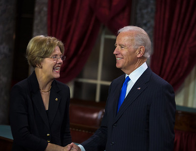 U.S. Senator Elizabeth Warren (D-MA) (left) participates in a reenacted swearing-in with Vice President Joe Biden. The ceremonial event took place in the Old Senate Chamber inside the U.S. Capitol Building in Washington D.C. on January 3, 2013. The official swearing-in ceremony happened earlier in the Senate chambers on the opening day of the 113th Congress. (Photo by Jeff Malet).