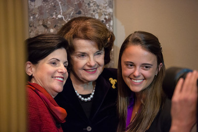 Three generations of Feinsteins. While waiting for her turn in a ceremonial swearing-in ceremony for U.S. Senate members of the 113th Congress with Vice President Joe Biden, Senator Dianne Feinstein (D-CA) poses for a snapshot with her daughter Katherine Feinstein Mariano, and granddaughter Eileen. Inside the U.S. Capitol Building in Washington D.C. on January 3, 2013. (Photo by Jeff Malet).