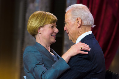 Freshman U.S. Senator Tammy Baldwin (D-WI) (L) warmly embraces Vice President Joe Biden during a reenacted swearing-in. The ceremonial event took place in the Old Senate Chamber inside the U.S. Capitol Building in Washington D.C. on January 3, 2013. The official swearing-in ceremony happened earlier in the Senate chambers on the opening day of the 113th Congress. (Photo by Jeff Malet).