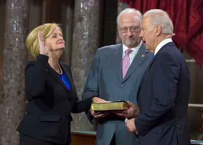 U.S. Sen. Claire McCaskill (D-MO) (L) participates in a reenacted swearing-in with her husband Joseph Shepard  and Vice President Joe Biden. The ceremonial event took place in the Old Senate Chamber inside the U.S. Capitol Building in Washington D.C. on January 3, 2013. The official swearing-in ceremony happened earlier in the Senate chambers on the opening day of the 113th Congress. (Photo by Jeff Malet).