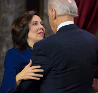 Vice President Joe Biden gets a hug from Senator Maria Cantwell (D-WA) during her mock swearing-in ceremony. The ceremonial event took place in the Old Senate Chamber inside the U.S. Capitol Building in Washington D.C. on January 3, 2013. The official swearing-in ceremony happened earlier in the Senate chambers on the opening day of the 113th Congress. (Photo by Jeff Malet).