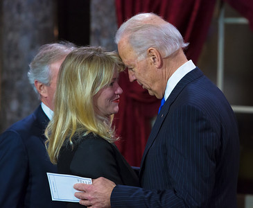 Vice President Joe Biden whispers to Elizabeth Corker, wife of U.S. Senator Bob Corker (R-TN) prior to a reenacted swearing-in. The ceremonial event took place in the Old Senate Chamber inside the U.S. Capitol Building in Washington D.C. on January 3, 2013. The official swearing-in ceremony happened earlier in the Senate chambers on the opening day of the 113th Congress. (Photo by Jeff Malet).