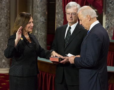 Newly-elected Senator Deb Fischer (R-NE) raises her right hand as she places her hand on a Bible held by her husband, Bruce in a reenacted swearing-in with Vice President Joe Biden. The ceremonial event took place in the Old Senate Chamber inside the U.S. Capitol Building in Washington D.C. on January 3, 2013. The official swearing-in ceremony happened earlier in the Senate chambers on the opening day of the 113th Congress. (Photo by Jeff Malet).