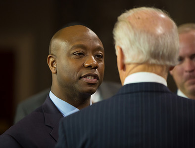 "U.S. Senator Tim Scott (R-SC) (left) tells Vice President Joe Biden ""looking forward to working with you"" during a mock swearing-in. The ceremonial event took place in the Old Senate Chamber inside the U.S. Capitol Building in Washington D.C. on January 3, 2013. The official swearing-in ceremony happened earlier in the Senate chambers on the opening day of the 113th Congress. (Photo by Jeff Malet)."