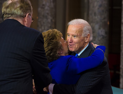 Vice President Joe Biden gets a warm hug from Gayle Manchin. U.S. Senator Joe Manchin (D-WV) participated in a reenacted swearing-in with his wife Gayle Conelly Manchin, U.S. Senator Jay Rockefeller (D-WV) (left in photo) and Biden. The ceremonial event took place in the Old Senate Chamber inside the U.S. Capitol Building in Washington D.C. on January 3, 2013. The official swearing-in ceremony happened earlier in the Senate chambers on the opening day of the 113th Congress. (Photo by Jeff Malet).
