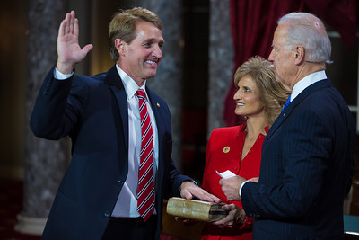 U.S. Senator Jeff Flake (R-AZ) (left) participates in a reenacted swearing-in with his wife Cheryl Flake and Vice President Joe Biden. The ceremonial event took place in the Old Senate Chamber inside the U.S. Capitol Building in Washington D.C. on January 3, 2013. The official swearing-in ceremony happened earlier in the Senate chambers on the opening day of the 113th Congress. (Photo by Jeff Malet).