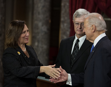 Newly-elected Senator Deb Fischer (R-NE) shakes hands with Vice President Joe Biden as husband Bruce looks on  in a reenacted swearing-in. The ceremonial event took place in the Old Senate Chamber inside the U.S. Capitol Building in Washington D.C. on January 3, 2013. The official swearing-in ceremony happened earlier in the Senate chambers on the opening day of the 113th Congress. (Photo by Jeff Malet).
